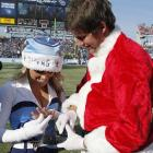 During halftime of the Titans-Saints game on Dec. 11, 2011, Tennessee cheerleader Janae Kram got quite the surprise when a man dressed as Santa Claus dropped to one knee and proposed. The man in red turned out to be her boyfriend, Ben Graham, a right-handed pitcher in the Washington Nationals farm system, and the couple is now happily engaged. Here are some other sports-related wedding proposals.