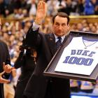 University President Richard Brodhead honors Krzyzewski for coaching his 1,000th career game at Duke. Krzyzewski is the winningest coach in Division I history with 903 wins (830 of them at Duke).
