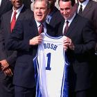 Then-President George W. Bush receives a jersey from Krzyzewski after Duke's 2001 national championship season. Krzyzewski has led Duke to four NCAA titles.Read more: http://sportsillustrated.cnn.com/multimedia/photo_gallery/1111/mike-krzyzewski-classic-photos/content.13.html#ixzz1fgKwV68s
