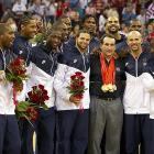 Krzyzewski celebrates with the Olympic team he coached after it defeated Spain in the gold medal game in Beijing. Krzyzewski also coached Team USA to gold at the 2007 FIBA Americas Championship and 2010 FIBA World Championships.