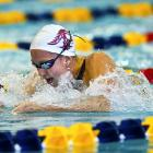 Rebecca Soni hurdles toward the finish line during the women's 100-meter breaststroke preliminary on Friday Dec. 2. Soni would go on to win gold in the women's 100 and 200 breaststroke.