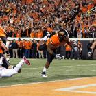 Will it be enough? Oklahoma State made its case for a BCS national championship game bid by destroying archrival Oklahoma in the Bedlam game. Jeremy Smith (pictured) rushed for 119 yards and two scores as the Cowboys racked up 495 yards on offense and forced five turnovers on defense.