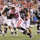 This, at least, was one rematch everyone could get behind. Wisconsin and Michigan State staged their second thrilling showdown of the season, but with a different result: Behind a four-touchdown night from Montee Ball (pictured) Wisconsin pulled out the win to earn back-to-back Rose Bowl berths.