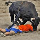 """We can't top the caption that came with this one -- """"An amateur bullfighter is caught with his pants down during the traditional bullfights in the Bullring of Zapote in San Jose, Costa Rica"""" -- but we will add that this isn't the most ideal sport for amateurs."""
