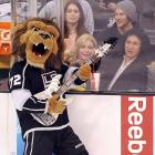 Kind of puts   Peter Criss's old cat makeup    to shame, don't it? The Los Angeles Kings mascot rock and rolls all night while the obviously impressed KISS bassist Gene Simmons (right) parties every day at Staples Center.