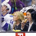 The KISS bassist and his Mrs. have reportedly been signed by the Vancouver Canucks. Here they are on the bench with new teammate Alex Burrows during the second period of an NHL game against the Kings in L.A. on New Year's Eve.