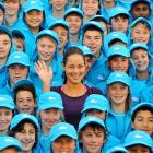 The Serbian racket-slinger waves frantically for help after being engulfed by ball boys and girls at the Australian Open -- that's a tennis tournament -- in Melbourne.