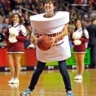 """She seems to be taking the slogan """"American runs on Dunkin"""" (or is it dunkin'?) a bit literally during an NCAA basketball game between the Temple Owls and the Dayton Flyers at the Liacouras Center in Philadelphia.  In case you're wondering, Dayton beat Temple 86-77."""