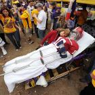 Crimson Tide fan Melissa McRae is overcome by the realization of the physical hazards her heroes had to brave while battling LSU at the Mercedes-Benz Superdome.