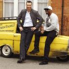 In London, two puglists posed with their Robin Reliant, a hot set of wheels that was featured in the television series  Only Fools And Horses . We're told women can't resist a man who drives one of these babies.