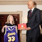 """A tall gentleman, who looks like he might have played basketball, showed up at the White House to present the Secretary of State with a Lakers uniform she vows to wear on only the most highly-sensitive, high-stakes diplomatic missions. He also handed her a copy of his book  What Color is My World? , to which she replied, """"Puce?"""" after gazing at the title."""