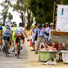 The peloton peddled past punters enjoying a lemon-fresh bath near the finish line of the great big bicycle race's first stage in Clare, Australia.