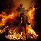 A man rode a horse through a bonfire in San Bartolome de Pinares, Spain, in honor of the patron saint of animals, who is also the patron saint of lost causes, a thought that must have occurred to the horse if not the rider, too. But this tradition dates back 500 years and is meant to purify the animals with smoke and protect them for the year to come. Camels, of course, make their own smoke.