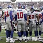 Manning calls a play in the huddle during his rookie year against the Baltimore Ravens. Eli was 1-7 as a starter during his first NFL season.