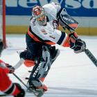 """After playing for Team USA at the World Junior Championships in Moscow, DiPietro is summoned from AHL Chicago for the third time, with accidentally mismatched equipment and a send-off from goaltending partner Wendell Young who tells SI's Michael Farber that DiPietro will need two airline seats -- one in coach for his body, the other in first class for his ego (his flight was cancelled due to a mechanical problem). The brash 19-year-old netminder makes his NHL debut on Jan. 27, 2001 vs.  Buffalo, producing 29 saves and being credited with an assist in a 2-1 loss. He sticks with the team and goes on to appear in 20 games in all, finishing with a 3-15-1 record and 3.49 GAA for the awful Isles, who finish last overall in the NHL.    CLICK HERE   to read Michael Farber's """"Teen Angel"""" (SI 02.19.01)"""