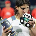 Even this stuffed panda couldn't avoid Rafael Nadal's signature bite after the finals of the men's China Open tennis tournament.