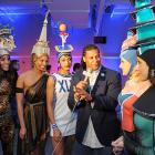 Ex-NFL player Cecil Martin interviews models dressed as Indianapolis city landmarks at the party.
