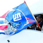 A flight attendant hails the Giants' arrival.