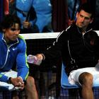 """After the match, Nadal (left) said of the marathon match: """"Physically, was the toughest match I ever played. ... I am tired."""" Nadal recorded a quality win over Roger Federer in the semifinals, but still is yet to find an answer for Djokovic."""