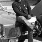 "Former 49ers running back Cedrick Hardman lounges on the hood of his Lincoln Continental in this 1970 shot. His Texas plate reads ""NASTY."""