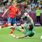 Spain overpowered Italy with a 4-0 victory in the Euro 2012 finals in Kiev, giving it  three major international titles in a row: Euro 2008, World Cup 2010 and Euro 2012.  Striker Fernando Torres scored one of the four goals, making him the first player to score in two Euros finals.