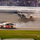 Clint Bowyer slides on the roof of his car after wrecking on the final lap of the 2007 race. Kyle Busch's spin out caused a pileup that flipped Bowyer, causing him to skid on his roof across the finish line for 18th place. Kevin Harvick won the race, beating Mark Martin by .02 seconds.