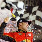 Jamie McMurray celebrates in the confetti at victory lane after winning the race in 2010. McMurray led for just two laps of the race, the fewest in Daytona 500 history, after making a late pass on Kevin Harvick who had led for 41 laps.