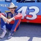 Richard Petty sits outside his No. 43 car at Daytona 500 qualifying in 1987. The King won Daytona a record seven times but finished third that year.