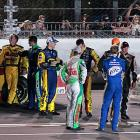 Keselowski (Miller Lite suit) takes a break between tweets to chat with his fellow drivers. Dave Blaney (second from left), a 75-to-1 underdog, was in the lead at the stoppage.
