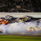 Reigning Sprint Cup champion Tony Stewart (bottom left) saw his hopes of breaking his Daytona 500 drought go up in smoke with a handful of laps to go.