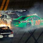 Five-time NASCAR champion Jimmie Johnson (top), Danica Patrick and defending Daytona 500 champion Trevor Bayne were involved in a wreck on the second lap. Elliott Sadler (not pictured) nudged Johnson from behind, turning the No. 48 into the wall and collecting other cars, including the No. 10 Patrick.