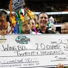 In the only bowl that really matters this week, Takeru Kobayashi couldn't stop eating. After inhaling a record 337 chicken wings in Philadelphia, he ingested the $20,000 winner's check before starting on his crown.