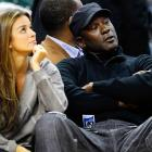 Whatever that young basketball player is doing to create quite a stir, the Charlotte Bobcats owner and his fiance dpn't look impressed. Then again, the young basketball player was not creating the stir in Time Warner Cable Arena in Charlotte, NC, where this photo was taken.