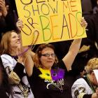 """Yes, it's Mardi Gras time in Pittsburgh. Non-hockey fans may be interested to know that """"Geno"""" is Penguins center Evgeni Malkin. No word if he rattled his beads for the benefit of these fine ladies."""