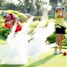 Fun with munitions continued this week in the world of golf where Paula Creamer tracked the ball after caddie Colin Cann nailed a rather explosive tee shot at the Tanah Merah Country Club in Singapore.