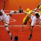 Tony Ontam (left) and Jeremy Mirken of the U.S. are either attempting to block a shot or they're engaged in some kind of exotic folk dance during their match against Malaysia at Palembang Sport Convention Center in Sumatra, Indonesia.