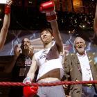 Kobayashi makes a boxing themed entrance.