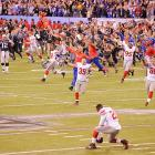 The Giants celebrate their Super Bowl victory by racing onto the field after New England's Hail Mary attempt fell incomplete