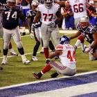 New York running back Ahmad Bradshaw (44) reluctantly crosses the goal line to put the Giants up 21-17 late in the fourth quarter.