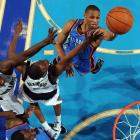 Oklahoma City guard Russell Westbrook goes in for a layup against the Mavericks