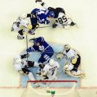 Pittsburgh goalie Marc-Andre Fleury (29) haplessly searches for the puck in a game against the Maple Leafs.