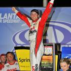 Denny Hamlin won his second straight Sprint Cup race, holding off Jeff Gordon in a green-white-checkered finish at Atlanta Motor Speedway. Hamlin took the series victory lead with four, putting him in position to top the standings when the 12-drive Chase starts.