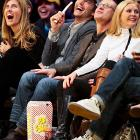 Obviously stoned on popcorn or overly amused by Kobe Bryant's mask, the popular actor enjoys the aerobic benefits of a laughing fit during an NBA basketball game in Los Angeles.
