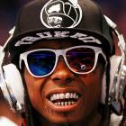 The beloved hip-hop artiste be lovin' him some diamond-studded headphones during the NBA All-Star Game.