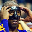 His busted beak still healing, the Lakers' superstar opted for the Hannibal Lecter look before a game against the Pistons in Detroit. (  CLICK HERE   for your free photograph of everyone's favorite psycho.) Alas, the hosts dined on their guests, 88-85.