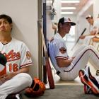 Pitcher Wei-Yin Chen (left) personifies the unbridled excitement of team photo day in Sarasota.