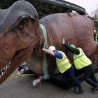 Workers at Chester Zoo in northern England battle one of 19 life-size replicas in the Dinosaurs Bite Back (yikes!) exhibition that opens on April Fools Day.