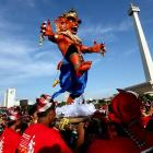 An effigy of the devil (looks like he's about to face off against the New York Rangers; see next photo) was paraded in Jakarta, Indonesia.