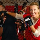 """Knockout Victoria Azarenka of Belarus connected with former UFC light heavyweight champion """"Suga"""" Rashad Evans in Miami."""