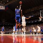 Brandon Rush shoots a three in Kansas' 2008 Final Four matchup against North Carolina. Rush led all scorers with 25 points to propel the Jayhawks past the Tar Heels, who were -- and still are -- coached by former Kansas head coach Roy Williams.